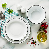set of white empty enamel bowls on the table. table setting