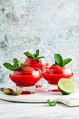 Berry Slushie with lime, Summer refreshing drink in serving glasses.