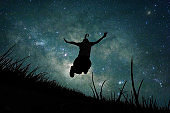 Young girl jumping into space