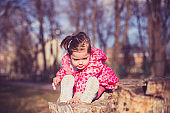 Young girl playing in the park on a sunny day
