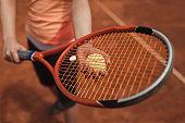 Close-up of a female tennis player preparing to serve