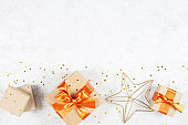 Background with craft gift boxes and golden stars