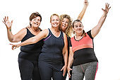 Female coach and overweight middle aged women group pic