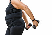 Overweight middle aged woman working out