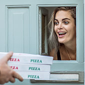 Pizza Delivery Man delivering food to a private residence