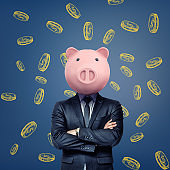 A businessman with folded arms stands wearing a pink pig mask on a background with chalk golden coins.
