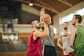 Competitive basketball players in action during the match.
