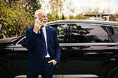 Senior adult businessman talking on the phone