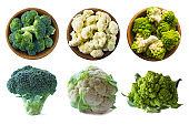 Broccoli, cauliflower and roman cauliflower in wooden bowl isolated on a white background. Three bowls of cabbage on a white background. Set of cabbage. Top view. Healthy food. Cabbage close-up. Vegetables with copy space for text.
