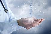 Doctor shows a DNA molecule .