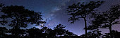 Silhouette Landscape Blue Starry Night with Milky Way Outdoor Activity Travel in Summer - Wide Size for Web Banner and Social Media Cover