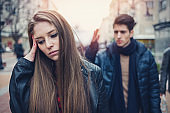 Young couple arguing on the street