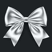 Realistic white bow isolated on dark background.