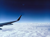 Aerial View from the Airplane Window Airplane Wing and Clouds blue sky freedom travel