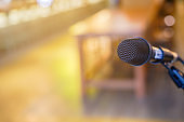 close up black standing microphone at convention hall in meeting education and business technology event concept