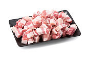 Raw pork meat pile isolated on white background
