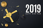 Happy New Year 2019 banner. Black gift box with a gold ribbon. Christmas balls. Confetti with serpentine. Scattered toys. Top view. Vector illustration. EPS 10
