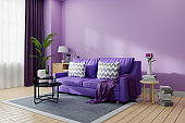 Cozy  living room interior decorated,Ultraviolet home decor concept ,purple sofa and black coofee table on light purple wall color and wooden floor ,3d render