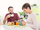 Young loving couple having breakfast at home
