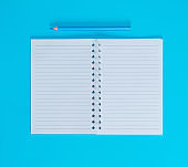 notebook with empty white sheets in line