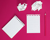 notebook with white sheets and a crumpled ripped out sheet of paper