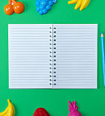 open notebook with blank white sheets in line