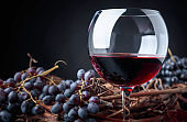 Glass of red wine and grapes.