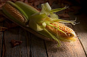 Sweet corn on wooden table.