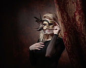 Portrait of beautiful woman with carnival mask.