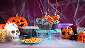 Halloween candyland drip cake style cupcakes in party table setting