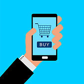 Businessman holding a smartphone with background for online buy.