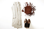Women's clothing set variations for fall season with warm garment items.