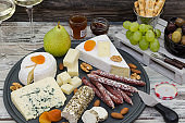 Various types of cheese. Cheese and meat appetizer selection. Wine snack set.
