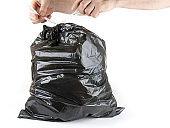 Tied up black trash bag ready to put to garbage