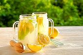 Summer healthy non alcoholic cocktails, citrus infused water drinks, lemonades with lime lemon or orange, diet detox beverages.