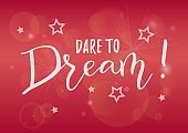 Calligraphy lettering of Dare to dream in white on pink background decorated with stars