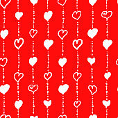 Seamless pattern for Valentine's Day. Cute hand drawn hearts and dots on red background