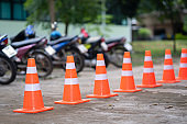 Traffic cone on road and blurred motorcycle