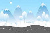 Winter landscape with road. Mountains and trees under the snow. Fantasy winter background template in flat style