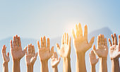 People raising hands for participation, many people's hands up. teamwork and competition concept