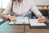 Business woman at working with financial reports