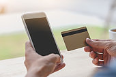 Man using mobile smartphone and credit card. Shopping Online