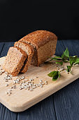 aromatic meal baking bread from dough on a wooden board on a beautiful background
