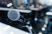 Microphone over the blurred business forum Meeting or Conference Training Learning Coaching Room Concept with noise, Blurred background.
