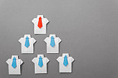 Leader in the team building. Staff recruitment, Human Resources Employment Job. Office workers in a shirt and tie. origami. Copy space for text