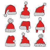 Set of hand drawn hats of Santa Claus.
