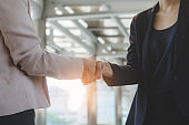 business woman shaking hand for complete business deal together successful. teamwork concept. partnership concept and dealership concept.