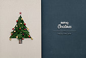 Merry Christmas and happy new year greetings in vertical top view dark blackboard with natural eco decorated christmas tree pine in cardboard.Xmas winter holiday season social media card background