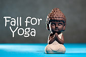 Fall for Yoga - Portrait of baby buddah practicing yoga indoor. Calmness and relax, happiness
