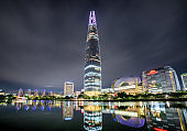Skyscraper and other modern buildings reflected in lake. Seoul